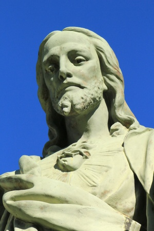 Close up of a white stone Jesus statue photo