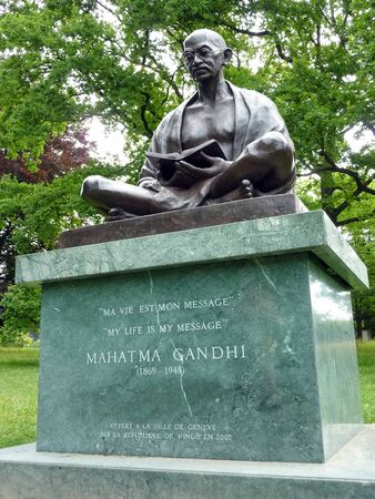 mahatma: Statue of Mahatma Gandhi sitting and reading a book in the Ariana park, Geneva, Switzerland. It was unveiled on november 14th 2007, to  commemorate the 60th anniversary of  Indo - Swiss  friendship. This is also a gift of the Indian Government to the City