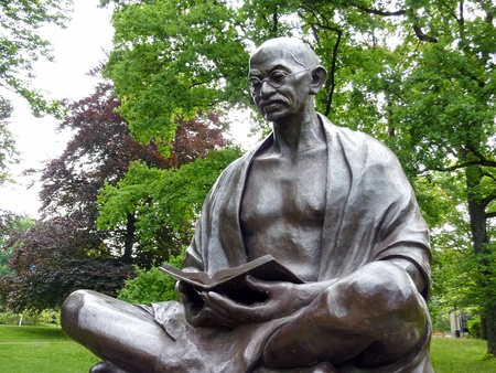 Statue of Mahatma Gandhi sitting and reading a book in the Ariana park, Geneva, Switzerland. It was unveiled on november 14th 2007, to  commemorate the 60th anniversary of  Indo - Swiss  friendship. This is also a gift of the Indian Government to the City