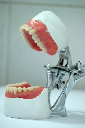 prosthetics: Dental lab articulator and white laboratory background Stock Photo