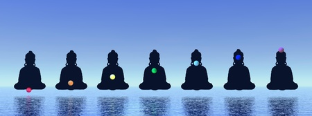 Seven chakras in meditation in blue background photo