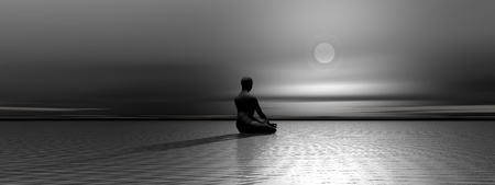 Man meditating upon the ocean in front of the moon by night photo