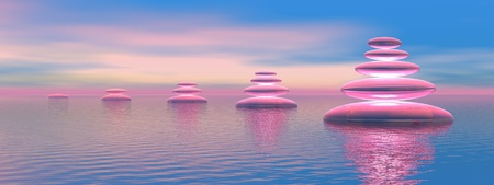 Growing balanced  stones upon the ocean in blue and pink background photo