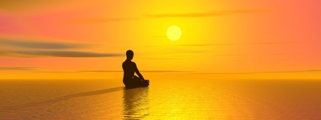 Man meditating in front of the sun and upon the ocean by beautiful sunset Standard-Bild