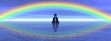 Shadow in meditation with chakras on the ocean and under a big beautiful rainbow