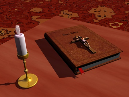 Bible with Jesus cross on it on a table next to a candle photo