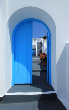 Colorful door and stairs in Santorini island, Greece