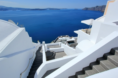 View on Aegean sea, islands and volcano from accomodation on Santorini, Greece, by beautiful weather photo