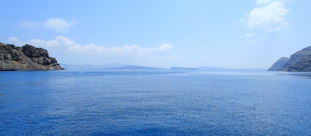 Panoramic view of aegean sea in the cyclades and the volcano from Thirassia island, Greece photo