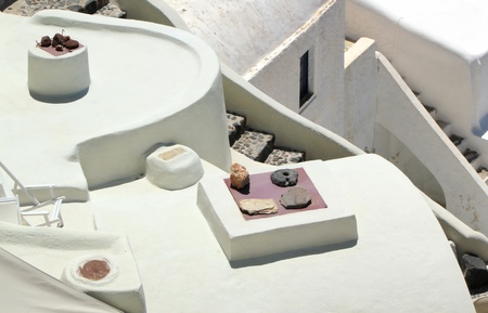 Close up on white architecutre with stairs, window and roof at Oia, Santorini, Greece, by sunny day  photo