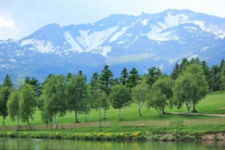 long lake: Long lake, trees at the golf place and mountain at Crans Montana, Switzerland