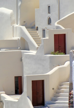 Close up on white architecutre with stairs, window and doors at Oia, Santorini, Greece, by sunny day. Stock Photo - 14191620