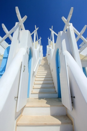 Beautiful colorful stairs with two walls going to the blue sky photo
