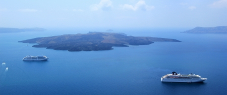 View on Santorini volcano and two cruise ships in the middle of Aegean sea, Cyclades, Greece, by beautiful weather photo