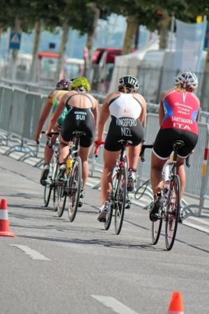 GENEVA, SWITZERLAND - JULY 22   unidentified female cyclists at the International Geneva Triathlon, on July 22, 2012 in Geneva, Switzerland  Stock Photo - 14542123