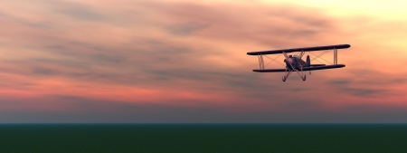 Old biplan flyinig upon the ground by colorful cloudy sunset Фото со стока