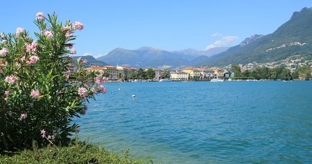 Landscape of Lugano city and lake with alps mountains, Switzerland photo