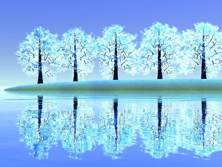 Beautiful winter landscape with trees reflecting into water by blue day photo