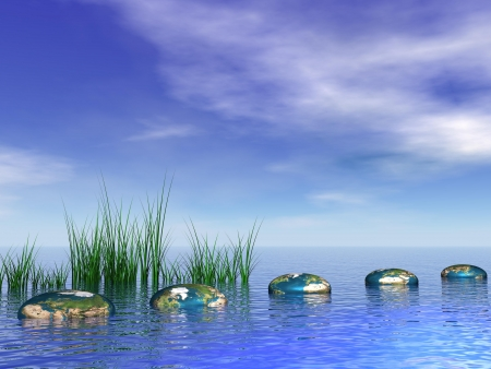 pebbles: Grey stones textured with earth map as steps and grass in the ocean in blue cloudy sky Stock Photo
