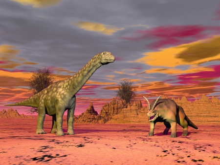 Two prehistorical animals in the desert by cloudy sunset