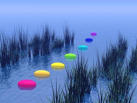 Sept cailloux aux couleurs des chakras sur l'océan d'un bleu profond et entre la végétation, l'horizon en arrière-plan