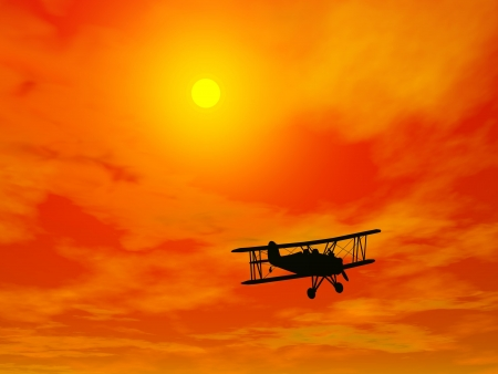Shadow of a small biplan flying in red sunset sky