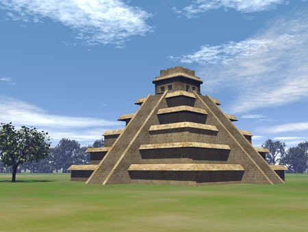 Maya pyramid on green grass and surrounded with trees by beautiful day Stock Photo
