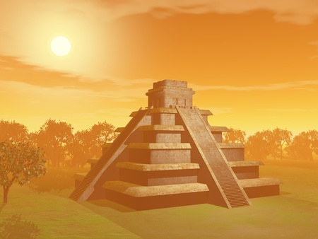 Maya pyramid on green grass and surrounded with trees by sunset foggy weather photo