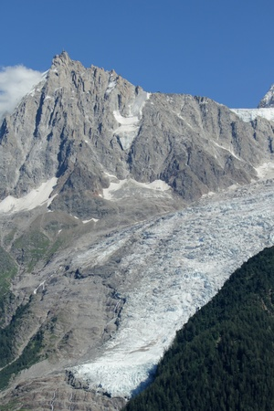 View on famous Aiguille du Midi and glacier des Bossons by beautiful weather at Chamonix, France Stock Photo - 17256695