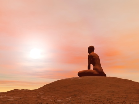 Young woman doing bound angle pose, baddha konasana, while practicing yoga outside in front of sunset photo