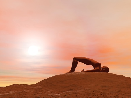 Young woman doing bridge pose, setu bandha sarvangasana, while practicing yoga outside in front of sunset photo