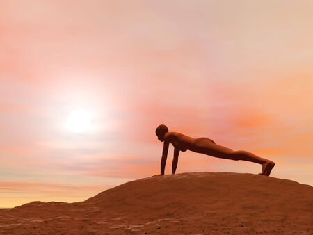 Young woman doing plank pose, adho mukha dandasana, while practicing yoga outside in front of sunset photo
