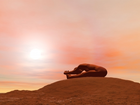 Young woman doing seated forward bend pose, paschimottanasana, while practicing yoga outside in front of sunset photo