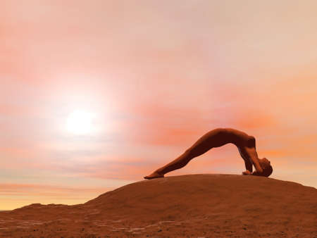 Young woman doing upward facing pose, dwi pada viparita dandasana, while practicing yoga outside in front of sunset photo