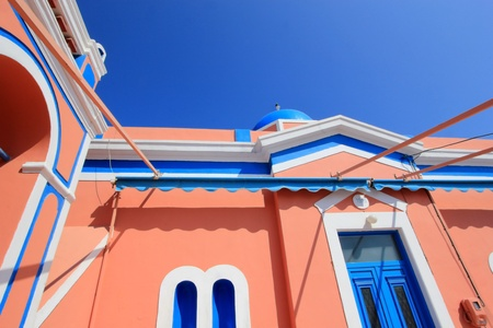 Close up of colorful orthodox church with typical architecture and blue dome in Oia, Santorini island, Greece Stock Photo - 17431376