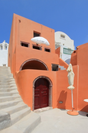 Colorful house next to stairs in Oia by beautiful waether, Santorini, Greece Stock Photo - 17431369