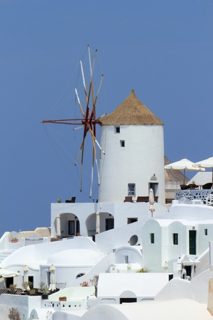 White old windmill at Oia village on the island of Santorini, cyclades, Greece Stock Photo - 17431370