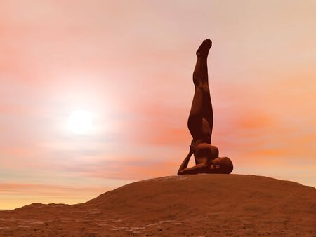 Young woman doing shoulder stand pose, sarvangasana while practicing yoga outside in front of sunset photo