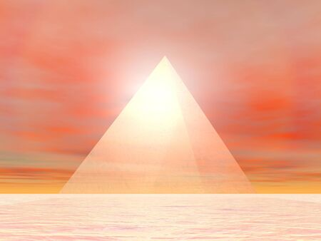 Transparent pyramid made of glass in front of sunset photo