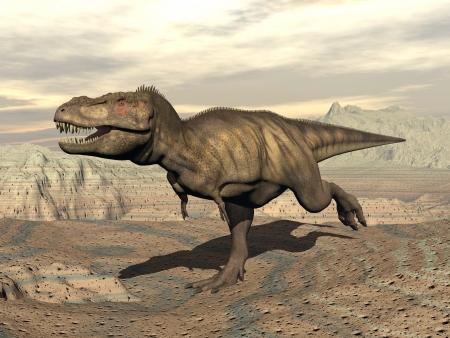 Tyrannosaurus dinosaur running in the desert by cloudy day Standard-Bild