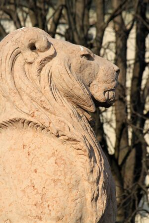 Lion made of stone guarding Brunswick monument at the entrance of Alps garden, Geneva, Switzerland photo