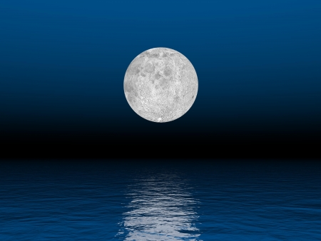 Beautiful full moon by deep blue  night over the ocean photo