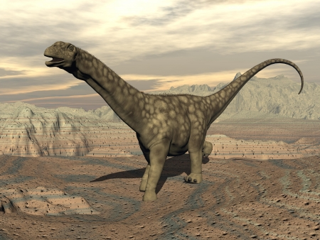 Big argentinosaurus dinosaur walking in the rocky desert by cloudy day Banque d'images