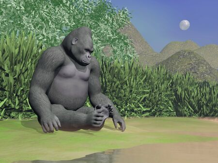 sitted: Gorilla thinking while sitted next to water in green landscape by night Stock Photo