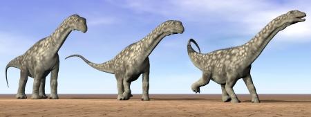 Three argentinosaurus dinosaurs standing in the desert by daylight photo