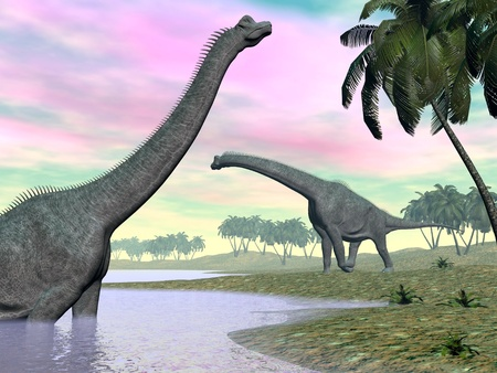 Two brachiosaurus dinosaurs in landscape with water and palm trees Stock Photo