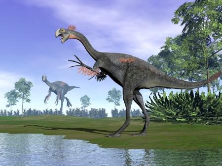 Zwei Gigantoraptor Dinosaurier stehen in der Natur mit Bäumen neben Wasser Standard-Bild - 19575588