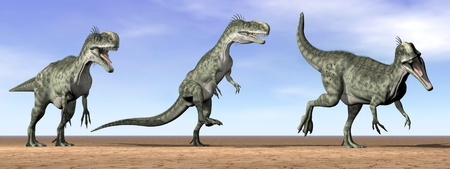 Three monolophosaurus dinosaurs standing in the desert by daylight Banque d'images