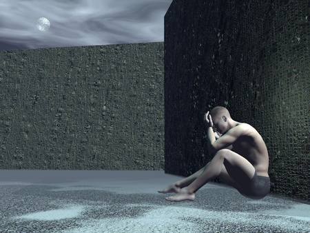 offended: Young man sitting alone in the street against a wall feeling sad by full moon light
