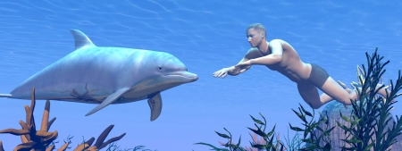 Man swimming underwater in front of a dolphin into the ocean photo